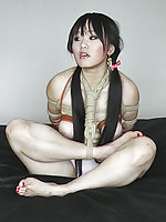 Pretty girl gets roped, hogtied and strapon fucked