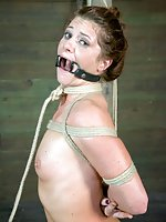 Cute girl lies on the floor, bound, gagged and blindfolded