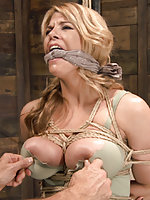 Huge tit milf tied tight, gagged with panties, suspended