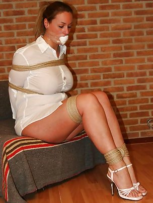 Busty beauty is roped, mouth-stuffed and tape-gagged