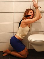 Eve in the bathroom - bound and cleave-gagged