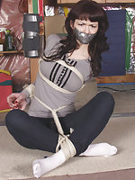 Tightly roped, tape-gagged, exposed