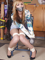 Roped to the chair and tape-gagged
